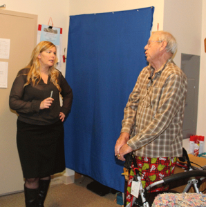 Corinna Lowe from Accessible Space, Inc. and resident Dale Bevins.